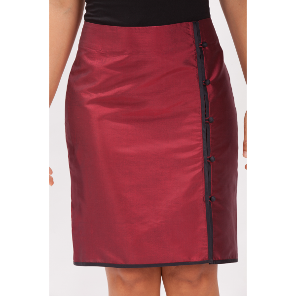 natural silk pencil skirt in dark red with contrasting black piping, covered buttons, side slit