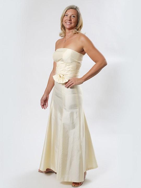 vanilla long gala dress in natural silk, wavy ruffles at the waist and a loose bow, flared skirt