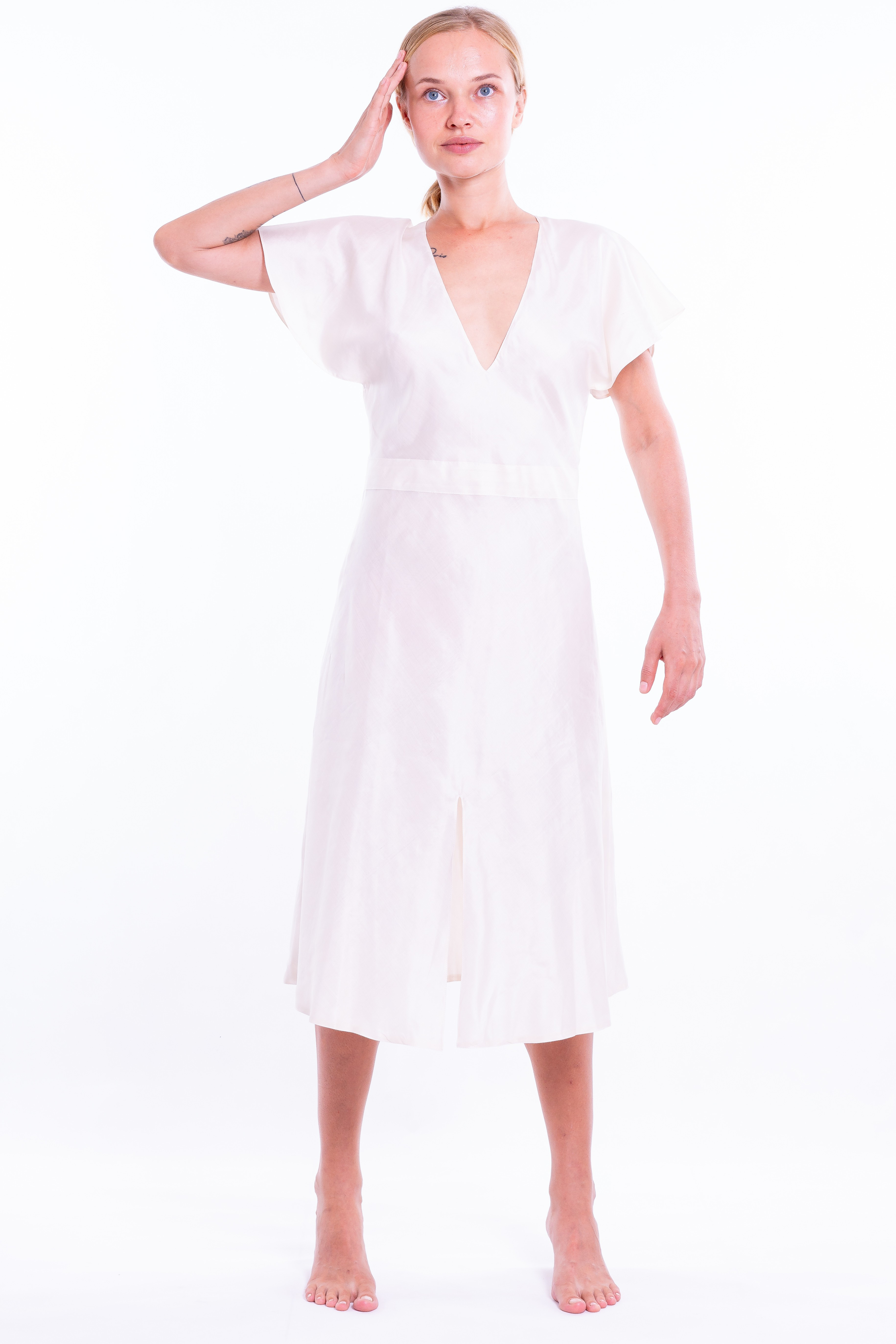 ivory chiffon silk, entirely lined, fitted waistline with flounced sleeves and deep V-neckline, front