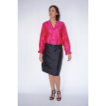 pink natural silk blouse with mother-of-pearl buttons and frills cuff handmade in Cambodia and black silk skirt, front