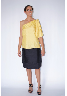 one shoulder natural silk top with draped sleeve and black silk skirt, front